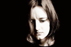 1200px-Sad_Woman